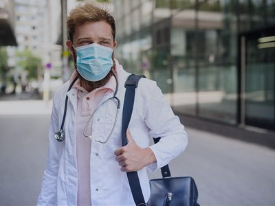 traveling nurse healthcare worker with mask