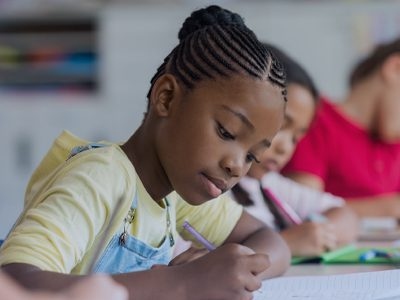 students in class writing