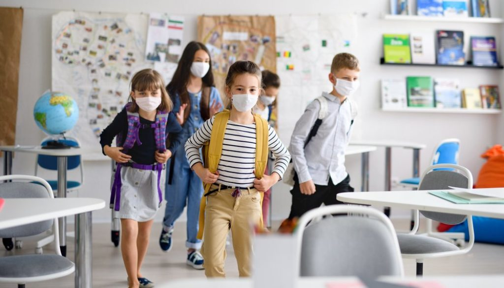 students in classroom wearing face masks